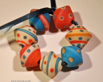 7 lampwork etched beads