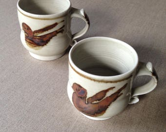 Two vintage Eileen Brooker pottery bird mugs / Australian pottery