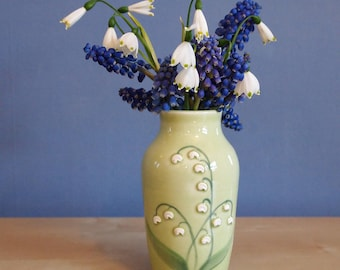 Bud vase with lily of the valley