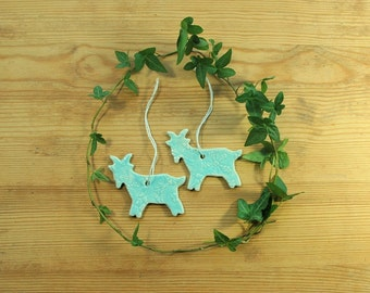 Ceramic goat ornaments - set of two, in white clay and with lace pattern.