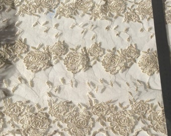 Embroidered lace on tulle gold color 33 cm in width for evening dress the meter