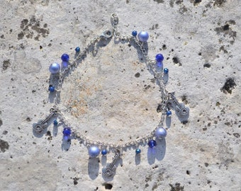 anklet guitar and blue beads