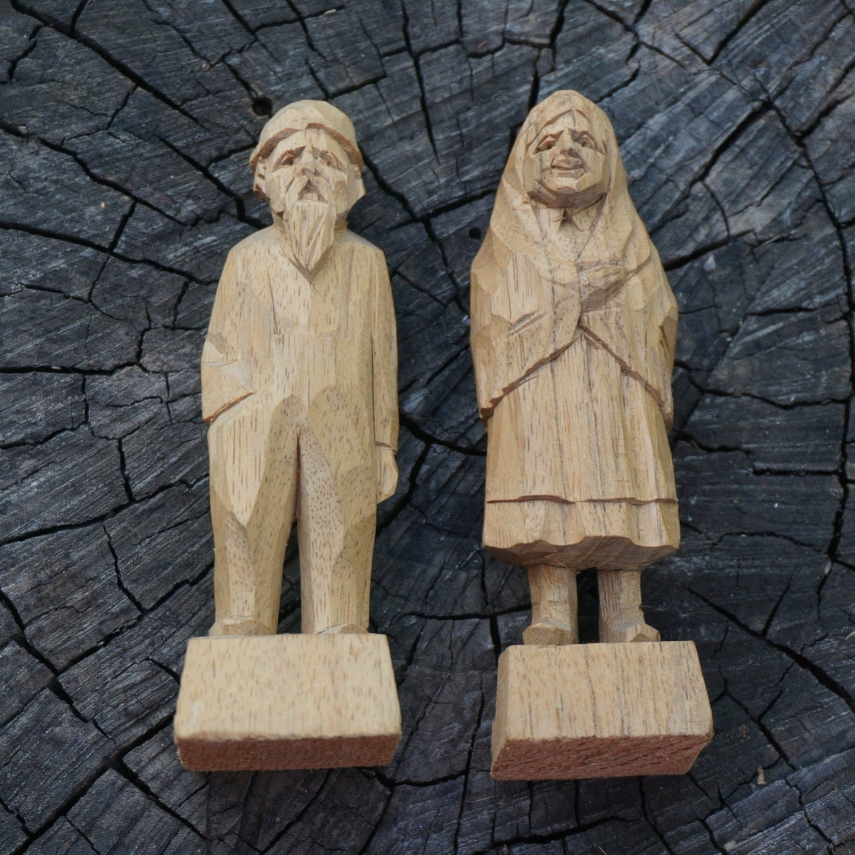 Vintage wood carvings old woman man st jean port joli