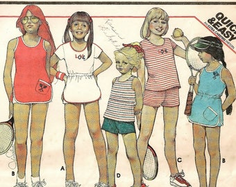 """A Set of Tennis Dresses Sewing Pattern - Dresses or Tops and Shorts - Includes New Transfer: Girls Size 12, Breast 30"""" • McCall's 5549"""