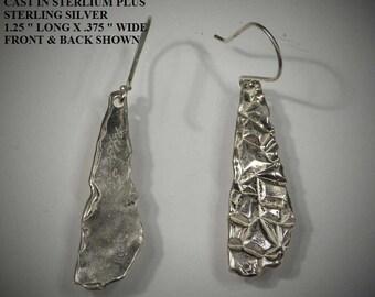 Drop earrings in sterling silver, different & unusual. Cast in sterling silver.  # 1011