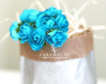 Les fleurs en papier turquoise 120 en vrac
