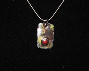 Eye catching enamel on copper necklace with sterling silver chain.