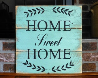 Home sweet home sign hand painted on reclaimed wood