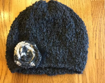 Hand knit hat with embellishment