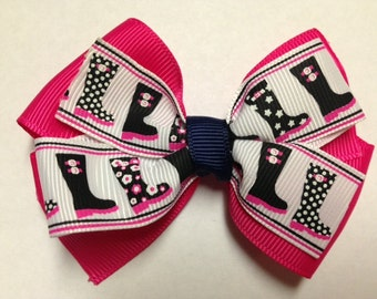 """3.5"""" rain boots shocking pink navy blue polka dot white hair bow birthday party favor pinwheel baby teen These boots are made for walking"""