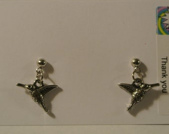 Silver Hummingbirds on Silver Posts
