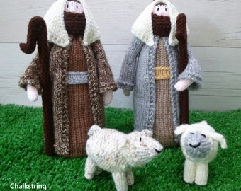 Knitted nativity shepherds and sheep. Nativity scene. Christmas decoration.