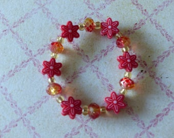 Bracelet elasticated red and gold flowers