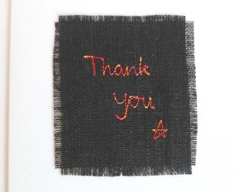 """Handmade thank you card. Embroidered card with """"Thank you"""" message in red thread, on black linen. White textured card. Blank inside."""
