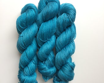 NEW Hand dyed merino and silk yarn 4ply finger weight 100g. In Night swiming. ethically sourced.