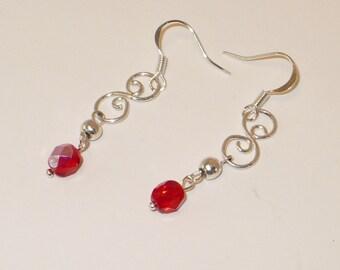 Silver scrolls and Czech crystal drop earrings.