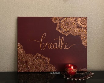 "intricate henna maroon and copper ""breathe"" henna canvas with rhinestone details"