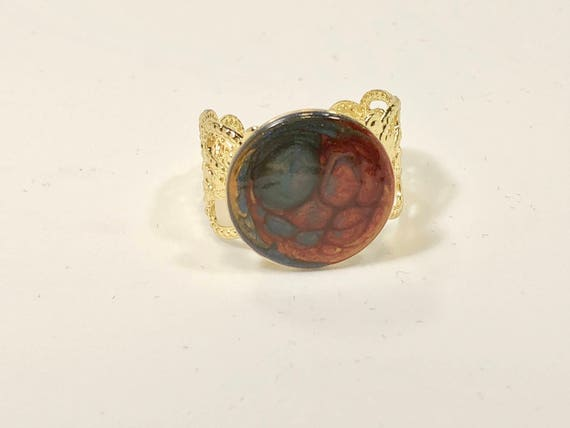 SJC10058 - Enamel painted antique brass adjustable ring with abstract designs (blue/red).