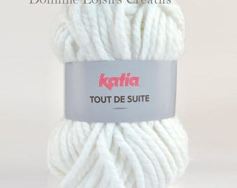 Ball of Katia now 200 grs 101 ivory collar