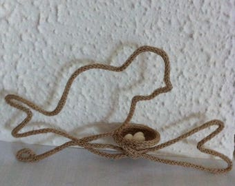 Bird knitting and wire on a branch and its nest