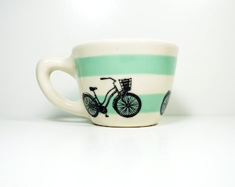 12oz cup with a Speedy Delivery bike print, shown here on stripes of Blue Green underglaze, Made to Order/Pick Your Color/Pick Your Print
