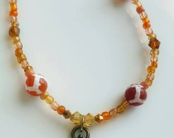 Orange beaded chain, Beaded chain, orange beads, orange necklace, casual necklace, beaded necklace, Fleur de lis necklace, fleur de lis