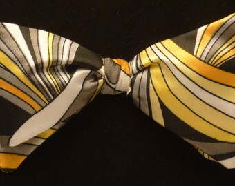 Sharp and crisp rich free style bow tie