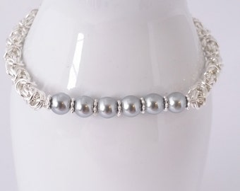 Silver pearl bracelet in byzantine chain maille weave. Silver plated rings, silver pearls and silver flowerette spacers.