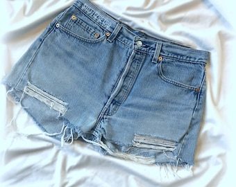 501 Vintage Distressed Levis Cut off Hem Size 34W Measures 31 inches