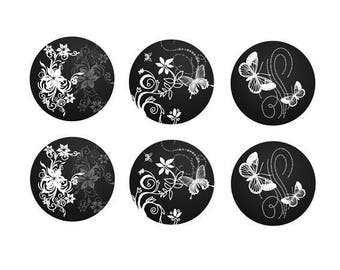 16mm, 6 pairs of white butterflies on black