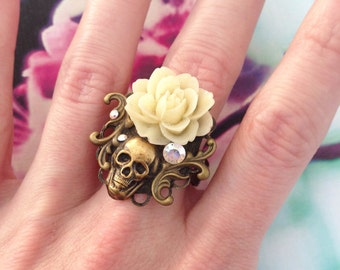 Adjustable beige flower and death's head ring