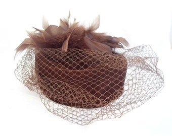 Dark brown vintage pillbox hat with veiling and feathers