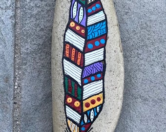 Painted feather on rock - rock painting
