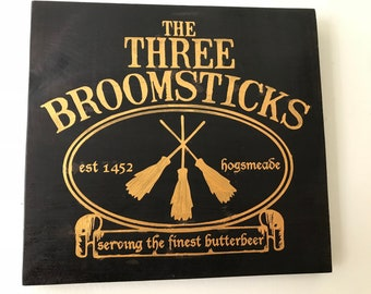 The Three Broomsticks wooden Harry Potter sign