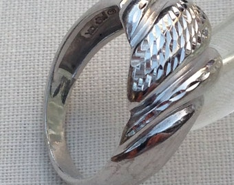 10k white gold shell hammered scalloped ring size 6 3/4 and it has 3.4 gms in total weight. circa 1980.