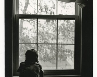 Boy at the window.Silver gelatin print