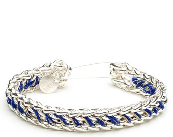 Silver bracelet embroidered with DMC blue pearl thread
