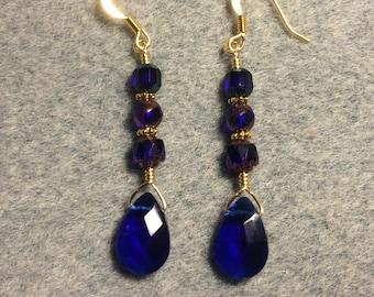 Cobalt blue briolette dangle earrings adorned with cobalt blue Czech glass beads.