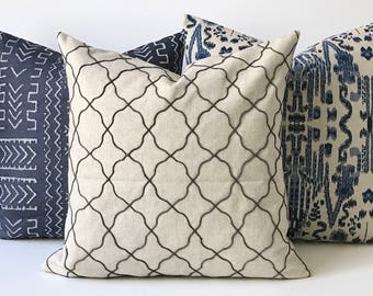 Charcoal gray and tan embroidered Moroccan quatrefoil geometric decorative pillow cover