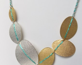 Silver and gold plated Sewn Up disc necklace - Statement necklace with turquoise thread