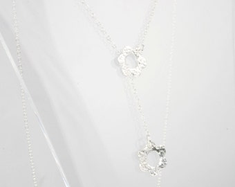 silver Y necklace with two smal flowers