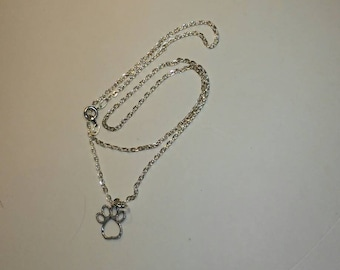 Sterling silver necklace with a paw print pendant.