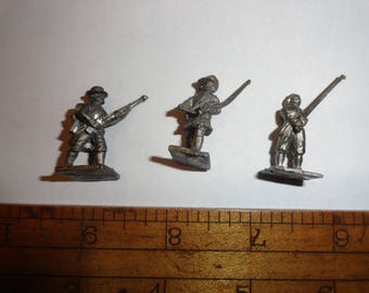 three pewter lead Soldiers with weapons and uniforms