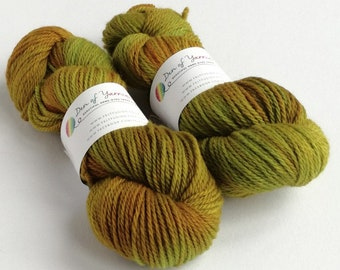 Hand dyed BFL aran yarn. Turning Leaves, greens, golds, orange. Indie dyed. aran weight. Suitable for cloth nappy covers. Knitting, crochet