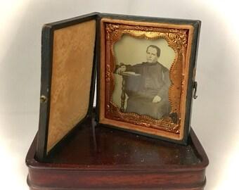 Antique photographs daguerreotype 1800's bound brown leather case duel photos antique collectibles