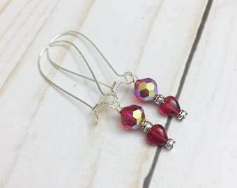 Romantic, red, crystal heart earrings with large French style ear wires with silver details by Jules Jewelry Box