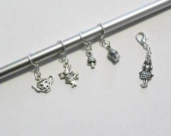 Alice in Wonderland Themed Sealed Ring Stitch Markers with a Lobster Claw Progress Keeper.
