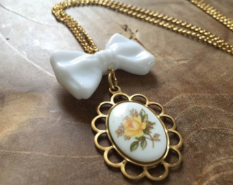 Classy Bow - a goldtone necklace with a white bow and cameo with a yellow rose. One of a kind