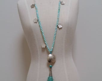 Long Turquoise and Coral necklace with a tassel.
