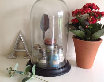 Cloche display of antique & vintage chemists items
